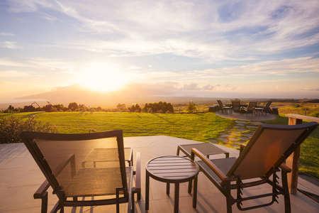Photo pour Lounge chairs on deck at sunset - image libre de droit