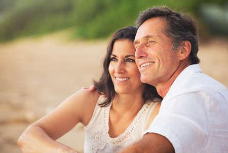 Photo pour Happy Romantic Mature Couple Enjoying Sunset on the Beach - image libre de droit