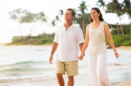 Photo pour Romantic Mature Couple Enjoying Walk on the Beach - image libre de droit