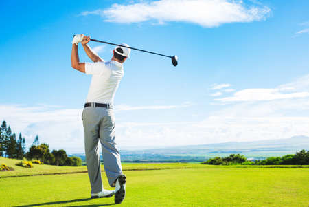 Photo pour Man Playing Golf on Beautiful Sunny Green Golf Course Hitting Golf Ball down the Fairway from the Tee with Driver.  - image libre de droit
