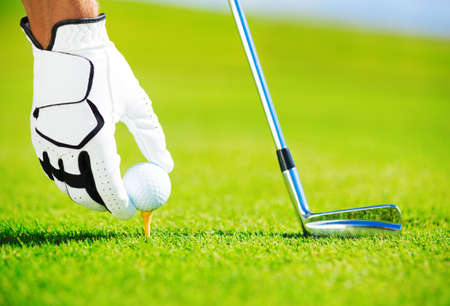 Photo for Man Placing Golf Ball on the Tee, Close up Detail  - Royalty Free Image