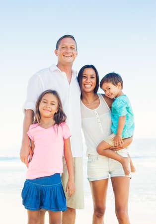Foto de Happy Portrait of Mixed Race Family on the Beach - Imagen libre de derechos
