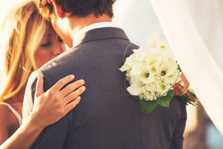 Photo pour Beautiful Wedding Couple Embracing. Bride and Groom in Love. - image libre de droit