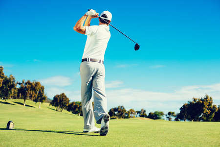 Photo for Golfer Playing on Beautiful Golf Course - Royalty Free Image