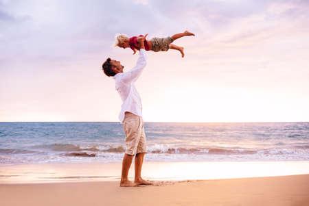 Foto de Father and Son Playing on the Beach - Imagen libre de derechos