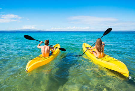 Photo for Couple Kayaking in the Ocean on Vacation - Royalty Free Image