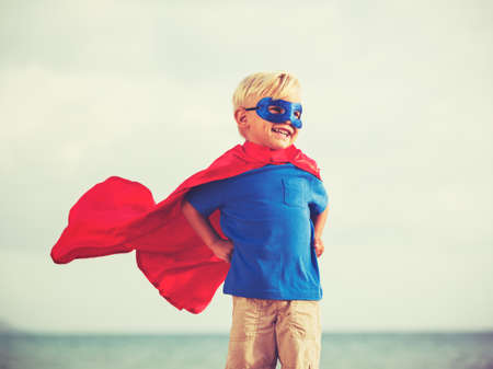 Photo pour Superhero Kid, Young Happy Boy Playing - image libre de droit