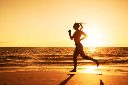 Photo pour Woman Running on the Beach at Sunset - image libre de droit