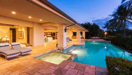 Photo for Beautiful Luxury Home with Swimming Pool at Sunset - Royalty Free Image