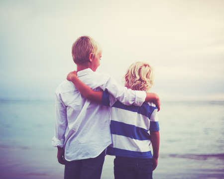 Photo pour Brothers, Happy young brothers hugging at sunset. Friendship brotherhood concept - image libre de droit