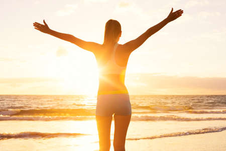 Foto per Happy successful fitness woman raising arms to the sky at sunset. Success, celebrating goals and achievement. Healthy Active Lifestyle. - Immagine Royalty Free