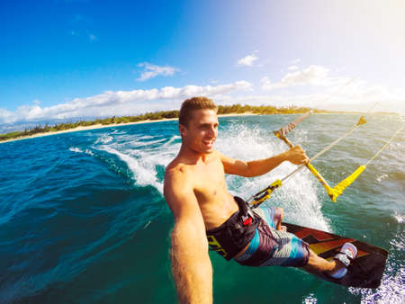 Photo pour Kiteboarding. Fun in the ocean, Extreme Sport Kitesurfing. POV Angle with Action Camera - image libre de droit