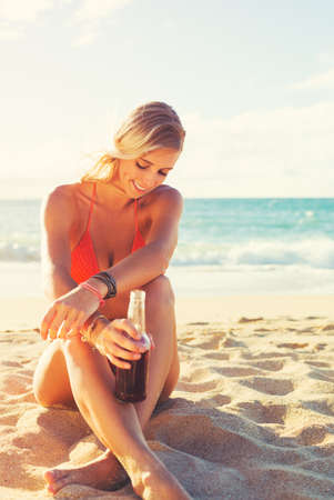 Summer Lifestyle, Beautiful Happy Carefree Young Woman on the Beach at Sunset