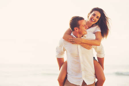 Photo pour Happy Young Romantic Couple Playing and Having Fun on the Beach - image libre de droit