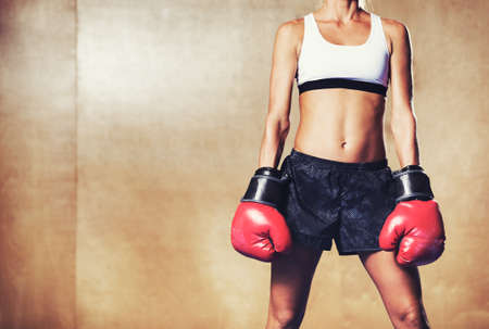Beautiful Woman with the Red Boxing Gloves. Attractive Female Boxer.