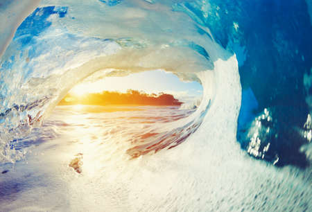 Foto de Blue Ocean Wave Crashing at Sunrise - Imagen libre de derechos