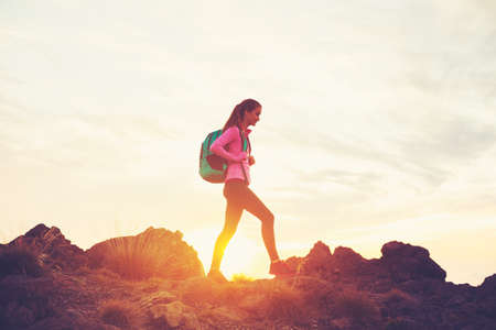 Foto de Woman Hiking in the Mountains at Sunset, Adventure Outdoor Active Lifestyle - Imagen libre de derechos