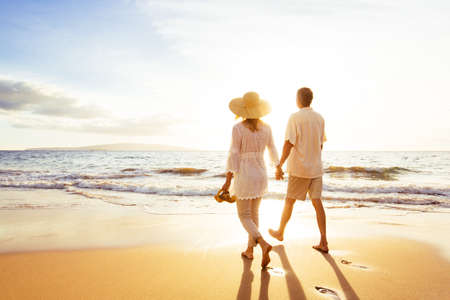 Photo pour Happy Romantic Middle Aged Couple Enjoying Beautiful Sunset Walk on the Beach. Travel Vacation Retirement Lifestyle Concept - image libre de droit