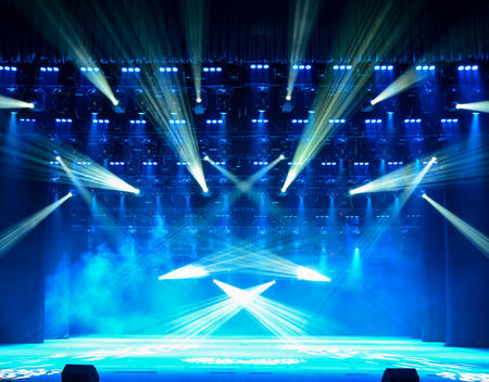 Photo for Illuminated empty concert stage with smoke - Royalty Free Image