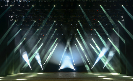 Photo for Illuminated empty concert stage with smoke and rays of light - Royalty Free Image