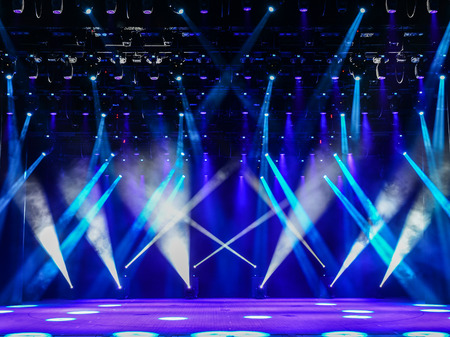 Photo for Illuminated empty theater stage with fog and blue rays of light - Royalty Free Image