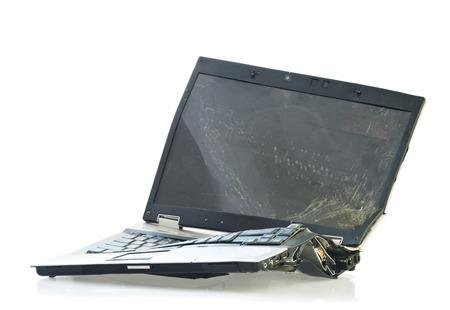 Foto de Laptop computer destroyed beyond repair in a car accident. Isolated on white background - Imagen libre de derechos