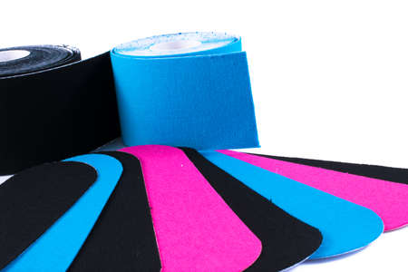 Foto de colorful kinesiology tape. Physiotherapy and therapeutic tape for wrist pain, aches and tension. elastic therapeutic tape. adhesive tape and alternative medicine. - Imagen libre de derechos