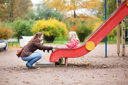 Photo for Mother and daughter having fun together on playground - Royalty Free Image