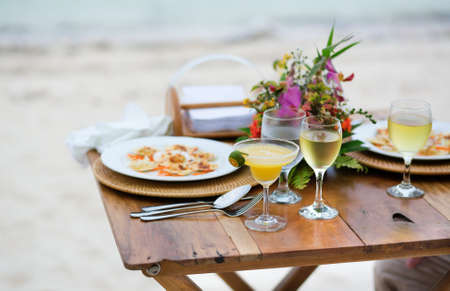 Romantic dinner served for two on a beach