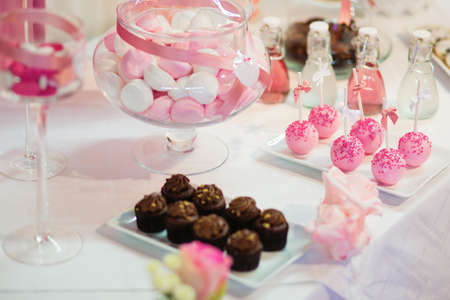 Photo for Pink cake pops on a dessert table at party or wedding celebration - Royalty Free Image