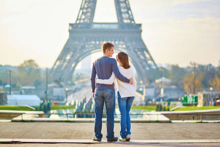 Photo for Beautiful romantic couple in Paris near the Eiffel tower - Royalty Free Image