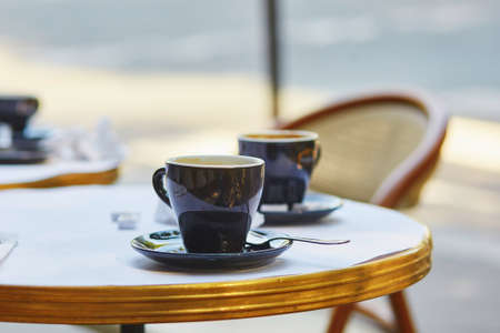 Photo for Coffee cups in an outdoor Parisian cafe - Royalty Free Image