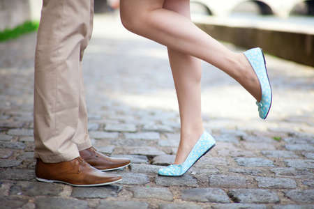 Photo pour Male and female legs during a romantic date - image libre de droit