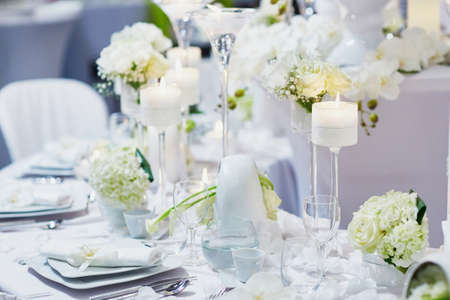 Foto für Beautiful table set with candles and flowers for a festive event, party or wedding reception - Lizenzfreies Bild