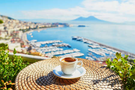 Foto de Cup of fresh espresso coffee in a cafe with view on Vesuvius mount in Naples, Campania, Southern Italy - Imagen libre de derechos