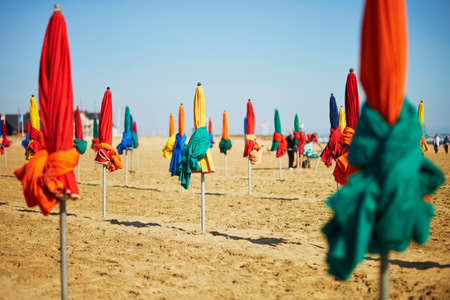 Photo for Many colorful umbrellas on the sand beach of Deauville, Normandy, France - Royalty Free Image