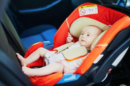 Photo pour 2 month old baby girl in car seat. Safe car trips for infants - image libre de droit