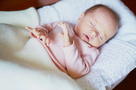 Photo pour Adorable baby girl sleeping in the crib. Little child having a day nap in cot. Infant kid resting in nursery - image libre de droit