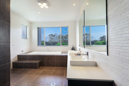 Modern twin bathroom with stylish bath