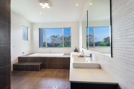 Modern twin bathroom with stylish bath