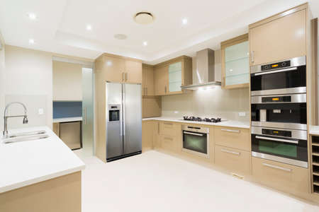 Foto de Modern kitchen with stainless steel appliances in Australian mansion - Imagen libre de derechos