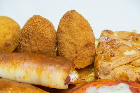 Photo pour Sicilian Cartocciata, Pizzetta, Cipollina and Arancino. A typical street food from Sicily. Made with ham, tomato, rise and cheese. - image libre de droit