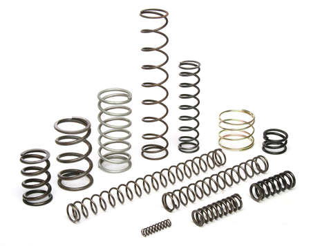 Various metal springs over white
