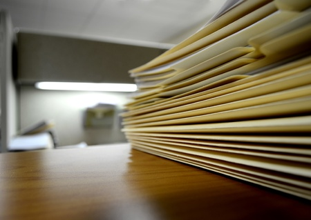 Desk or shelf full of folders and files in an office