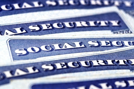 Photo pour Closeup detail of several Social Security Cards representing finances and retirement - image libre de droit