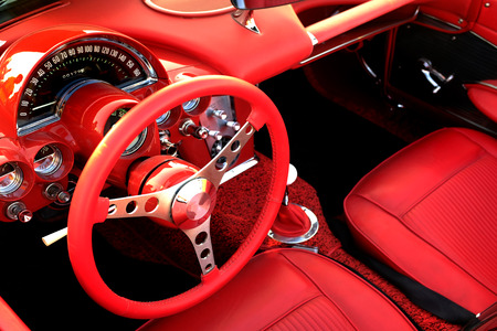 Photo pour Detail of interior red sports car steering wheel speedometer - image libre de droit