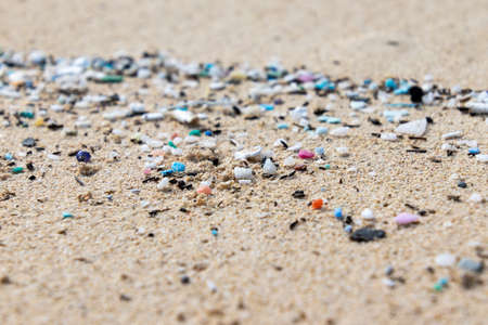 Photo pour Micro Plastics Washing Ashore On The Beach In Hawaii, USA - image libre de droit