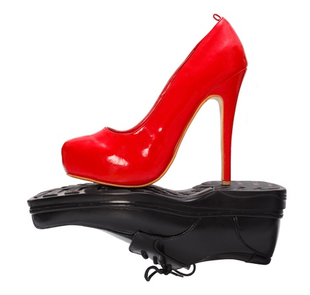 High heel red woman shoe against black man shoe