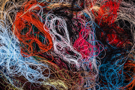 Foto de Bunch of tangled colorful sewing threads background - Imagen libre de derechos