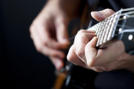 Photo for Man playing electric  guitar  - Royalty Free Image